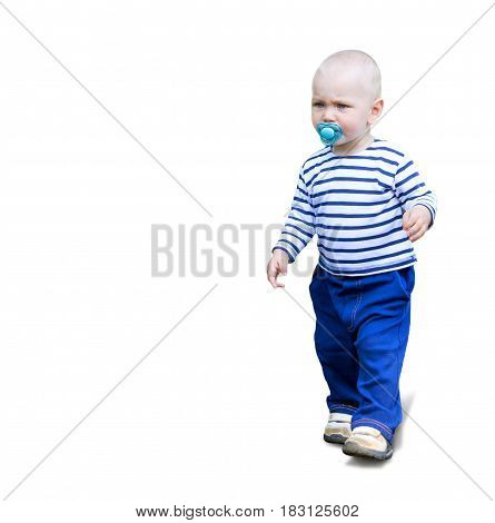 Serious Little kid toddler goes outdoor with soother pacifier in his mouth. One year baby boy isolated on white