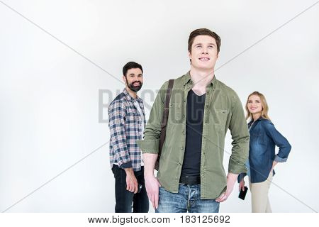 young man with friend behind in studio on white with copy space