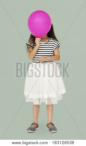 Young is holding pink balloon cover her face