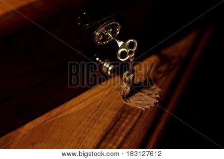 Close-up photography of key in keyhole of wooden cupboard