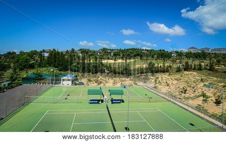 Green Tennis Court At Sunny Day
