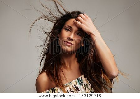 Woman With Hair Flying In Air
