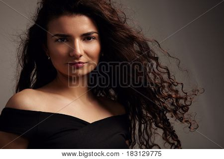 Pretty Smiling Young Model With Ideal Skin And Curly Hair