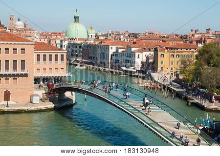 VENICE, ITALY - 09.04.2017: Main street with canal bridge boats and tourists in Venice Italy