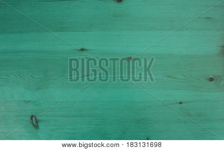 Turquoise painted wood background. Texture of rustic wood painted in turquoise. Wooden rustic background. Vintage turquoise wood.