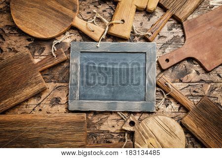 various wooden cutting boards on wooden kitchen table. Top view