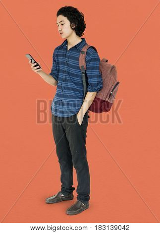 Young man full body using smart phone