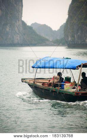 Halong Bay Vietnam - March 7 2017: fishingl boat near Cat Ba island Halong Bay Vietnam