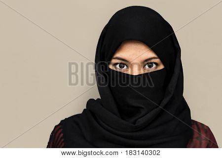 Middle eastern woman in hijab studio portrait
