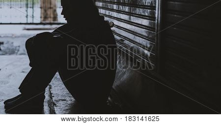 Homeless Woman Sitting on The Street Side Hopeless