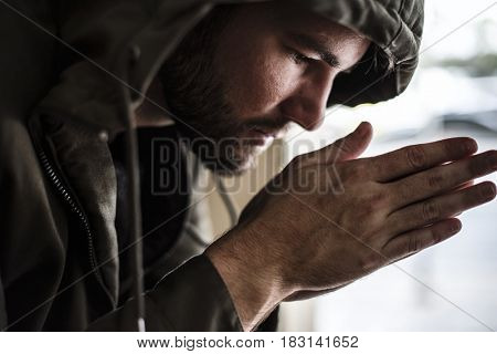 Thoughtful Homeless People Feeling Cold in Winter