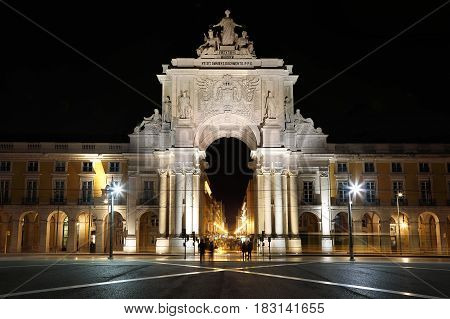 Night view photography of triumphal Rua Augusta Arch seen from Commerce Square in Lisbon Portugal