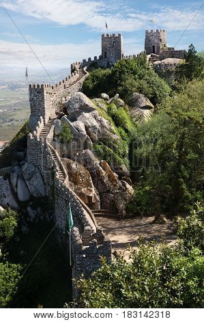 The Castle of the Moors is a hilltop medieval castle located in the municipality of Sintra about 25km northwest of Lisbon Portugal