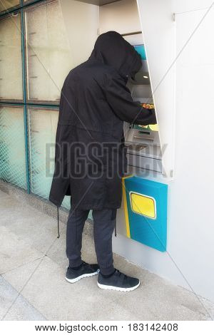 Stealing password and identity on atm machine computer crime