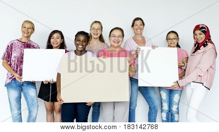Group of women feminism togetherness smiling holding board