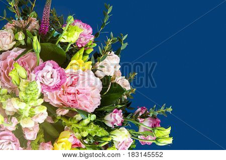 Spring slower in beautiful bouquet with empty area for your text or design on the blue area