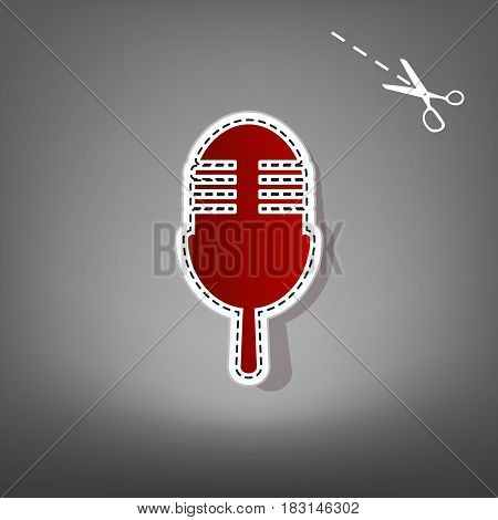 Retro microphone sign. Vector. Red icon with for applique from paper with shadow on gray background with scissors.
