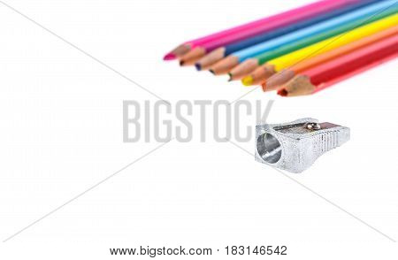 Set Of Old Used Broken Colour Pencils And Metal Sharpener.