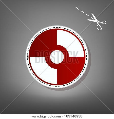Vector CD or DVD sign. Vector. Red icon with for applique from paper with shadow on gray background with scissors.