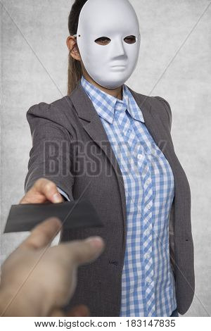 A Woman In A Mask Gives An Envelope