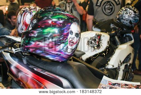 St. Petersburg Russia - 15 April, Exclusive drawings on moto helmets,15 April, 2017. International Motor Show IMIS-2017 in Expoforurum. Visitors and participants of the annual moto-salon in St. Petersburg.