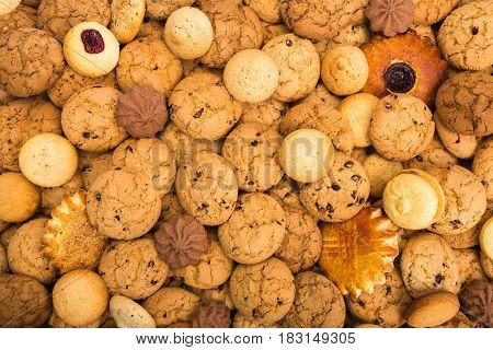 Cookies background. Sweet chocolate chips biscuits, shortbread with jam texture background. Oatmeal, chocolated drops and other sweets.