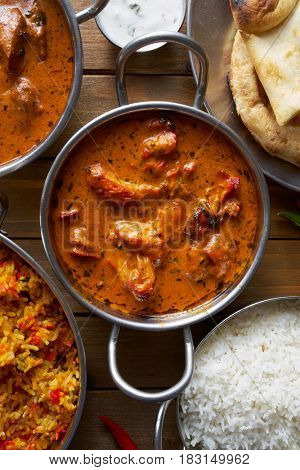 top down image of Indian butter chicken in balti dish