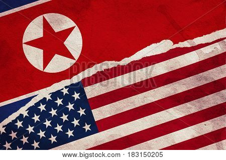 USA and North Korea Flag painted on old grunge paper.
