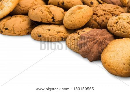 Cookies background frame isolated on white, copy space. Chocolate chips biscuits heap