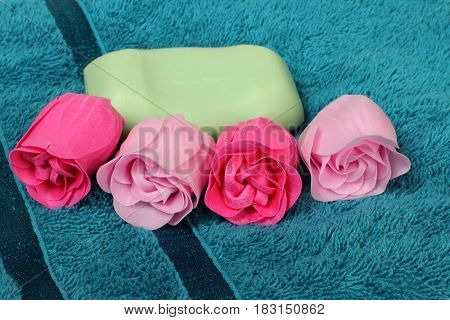 Pieces of soap on towel background