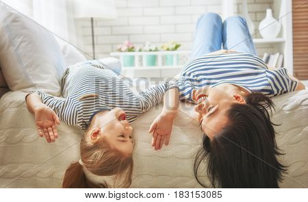 Happy mother's day! Mom and her daughter child girl are playing and smiling. Family holiday and togetherness.