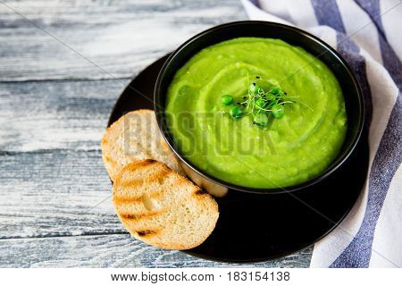Homemade Puree Soup With Green Peas And Micro Greens. Selective Focus