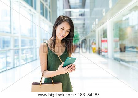 Young Woman enjoy shopping and using cellphone