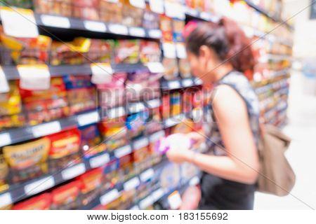 Supermarket interior and storage shelf on blur scene.