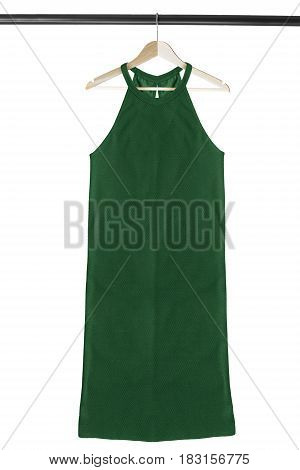 Green halter dress on wooden clothes rack isolated over white