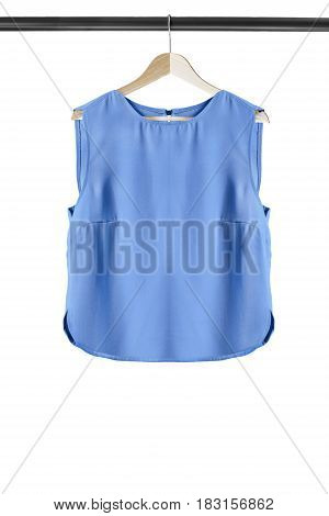 Blue sleeveless crop top on wooden clothes rack isolated over white