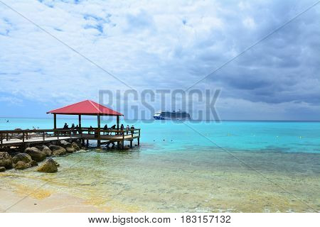 ELEUTHERA BAHAMAS - MARCH 21 2017 : View from Princess Cays on Royal Princess ship anchored at sea. Princess Cays is a private resort of Princess Cruises on Eleuthera island