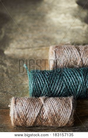 A ball of jute thick threads of brown and green. 3 skeins