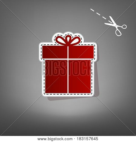 Gift sign. Vector. Red icon with for applique from paper with shadow on gray background with scissors.