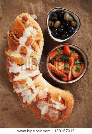 Home made bread  stuffed with mozzarella cheese and prosciutto