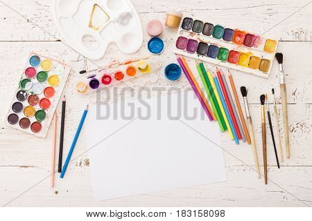 Top view on colorful paints and brushes. Creative ideas creativity and early learning. Education concept.