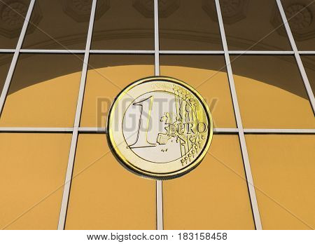 coin 1 euro on a yellow background