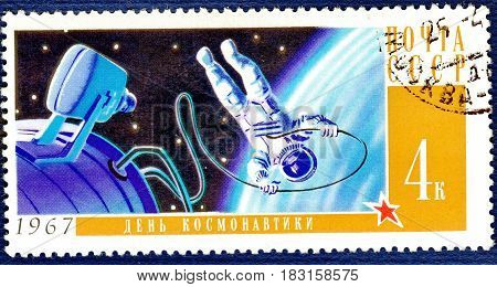 USSR - CIRCA 1967: Postage stamp printed in USSR shows Soviet cosmonaut in open space, with an inscription