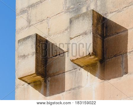 Maltese Stone Wall Building Detail With Blue Sky