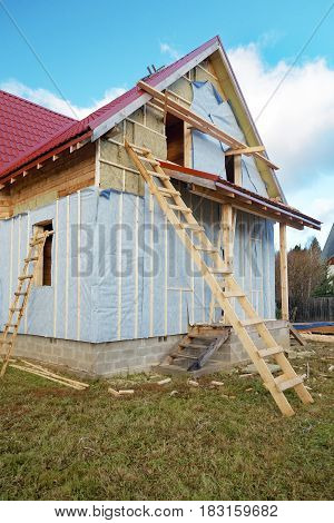 The under construction wooden house autumn sky blue