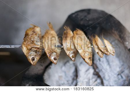 Close up Dried fish are grilled on stove