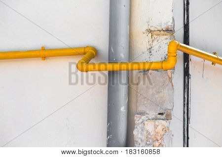Plumbing Running On The Outside Of A Building