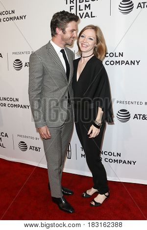 NEW YORK-APR 22: Dan Stevens (L) and wife Susie Hariet attend the 'Permission' screening at SVA Theatre during the 2017 TriBeCa Film Festival on April 22, 2017 in New York City.