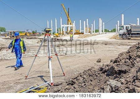 Zrenjanin Vojvodina Serbia - May 30 2015: Surveyors ensure precise measurements before undertaking large construction projects.