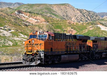 March 10, 2017 in Cajon, CA  BNSF Freight Train riding southbound transporting cargo to LA and beyond taken in Cajon, CA where people can watch trains up close at a barren desert landscape
